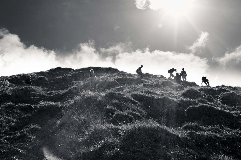 hjorthmedh-pdoc-hike-backlit-climb