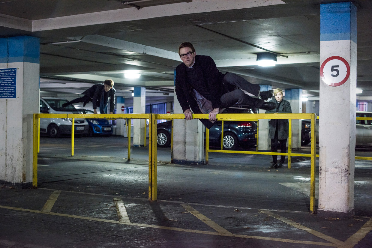 Sam Knights and Oli MacFarlane jumping over fences, with Heather Fantham