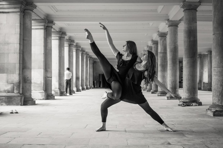 Domy Cooper and Holly Rachel Willis under the Wren Library, Trinity College, Cambridge.