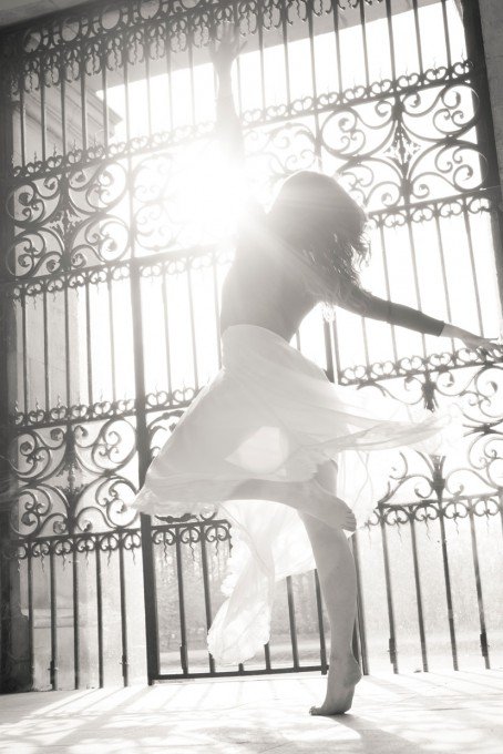 Hannah Copeland spinning with the sun in the background. Dancing at Trinity College, Cambridge.