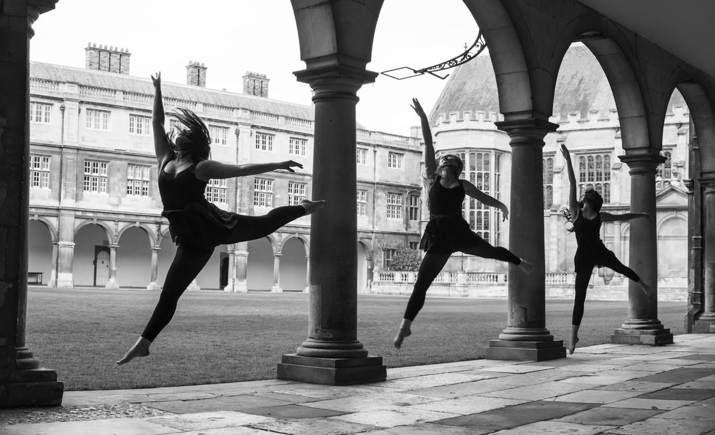 Rebecca Green, Harriet Neha Wright and Anahita Talwar jumping at Nevile's Court.