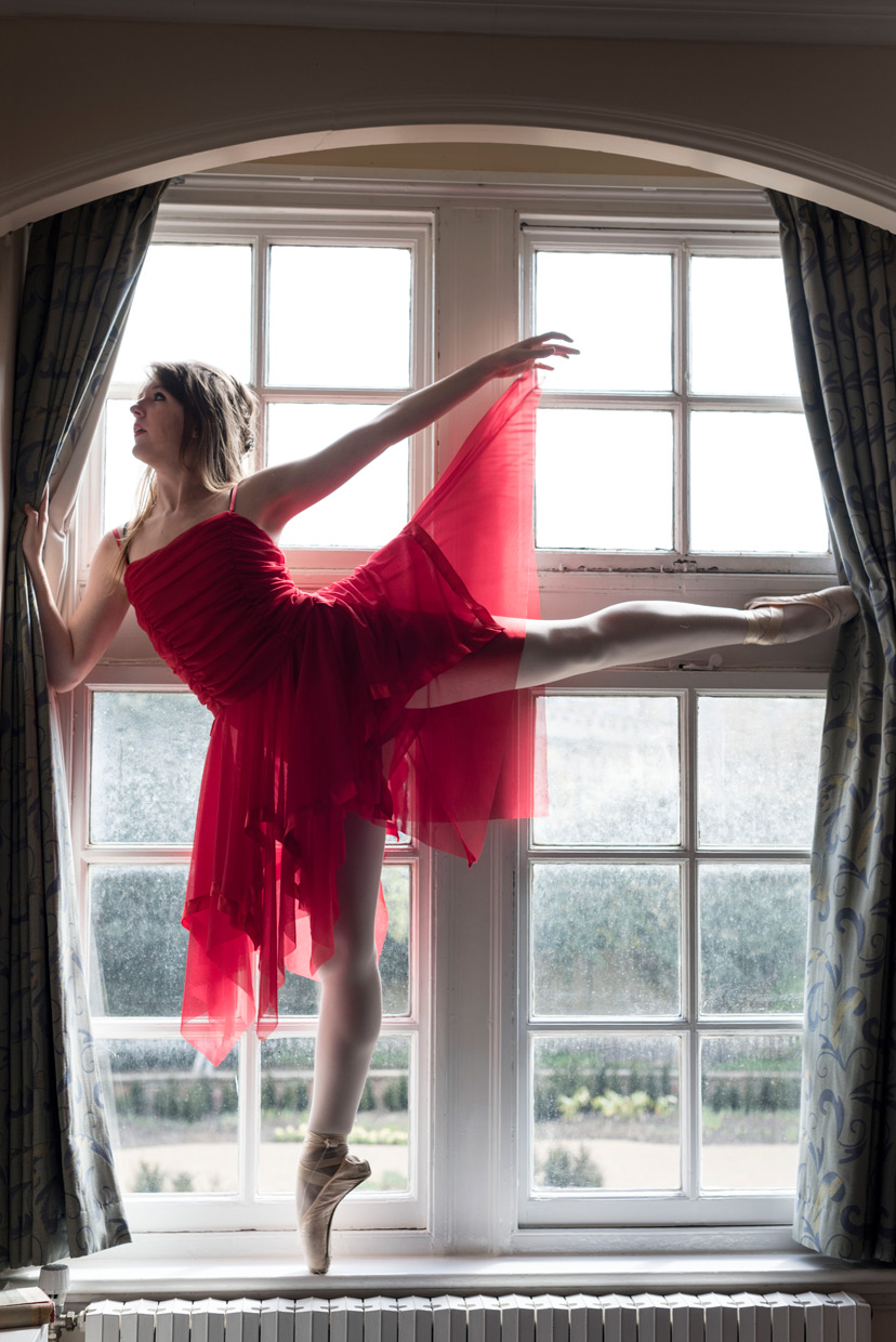 Arabesque in the window on pointe.