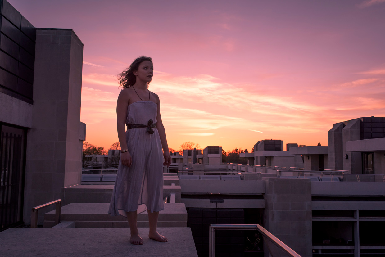 Katurah Morrish standing on the roof of Cripps building at sunset