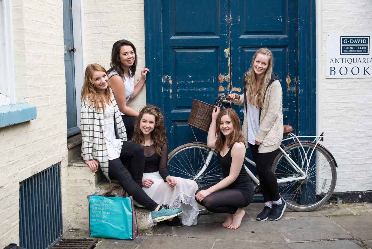 Charlie Grieco, Rebecca Green, Hannah Copeland, Holly Willis and Harriet Neha Wright in front of the blue door. St Edward's Passage, Cambridge.