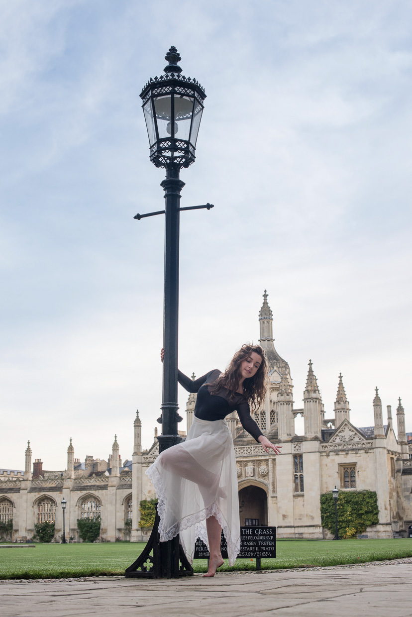 Hannah Copeland posing in front of a lamp post at King's College, Cambridge.