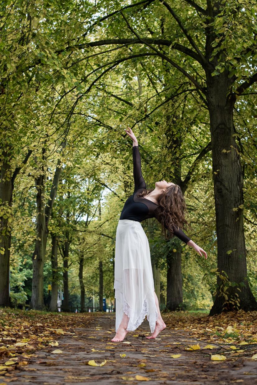 Hannah Copeland striking a pose. Barefoot among autumn leaves.