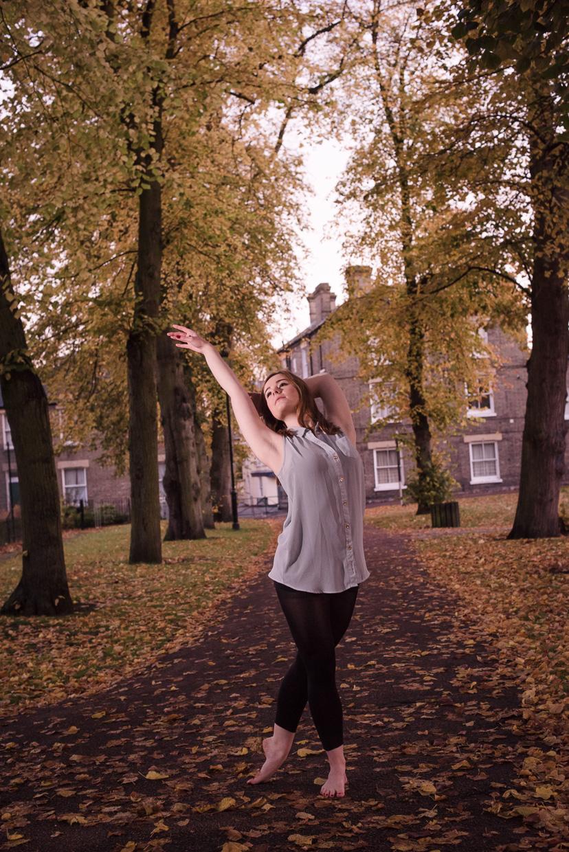 Holly Willis dancing barefoot at dawn.