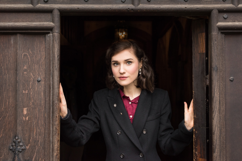 Hannah Grace Taylor in a doorway at Peterhouse.