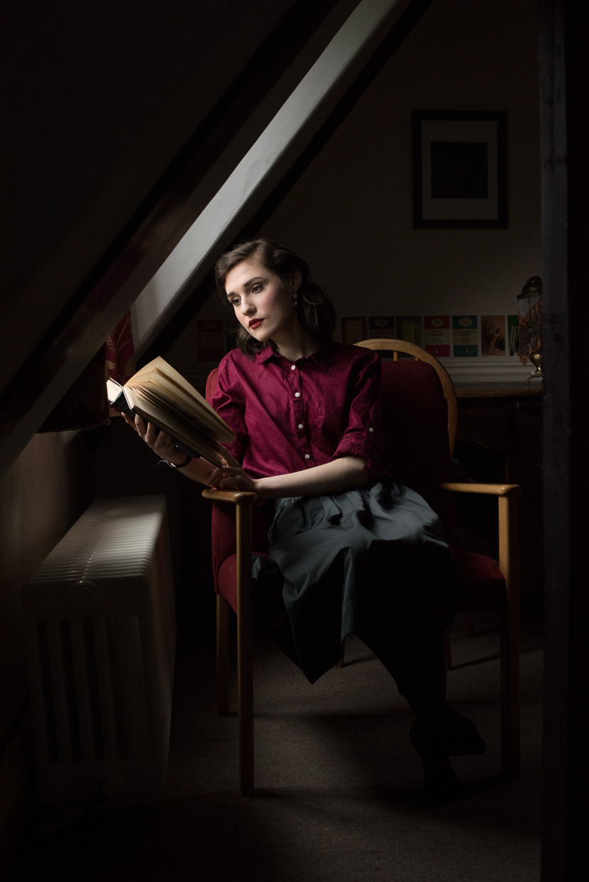 Hannah Grace Taylor reading a classic by the window at Peterhouse.