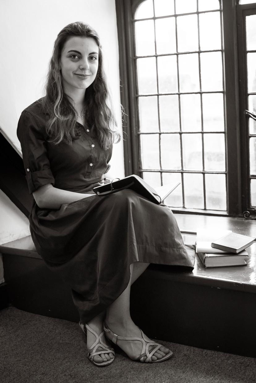 Shanti Daffern reading a book at Peterhouse, Cambridge.