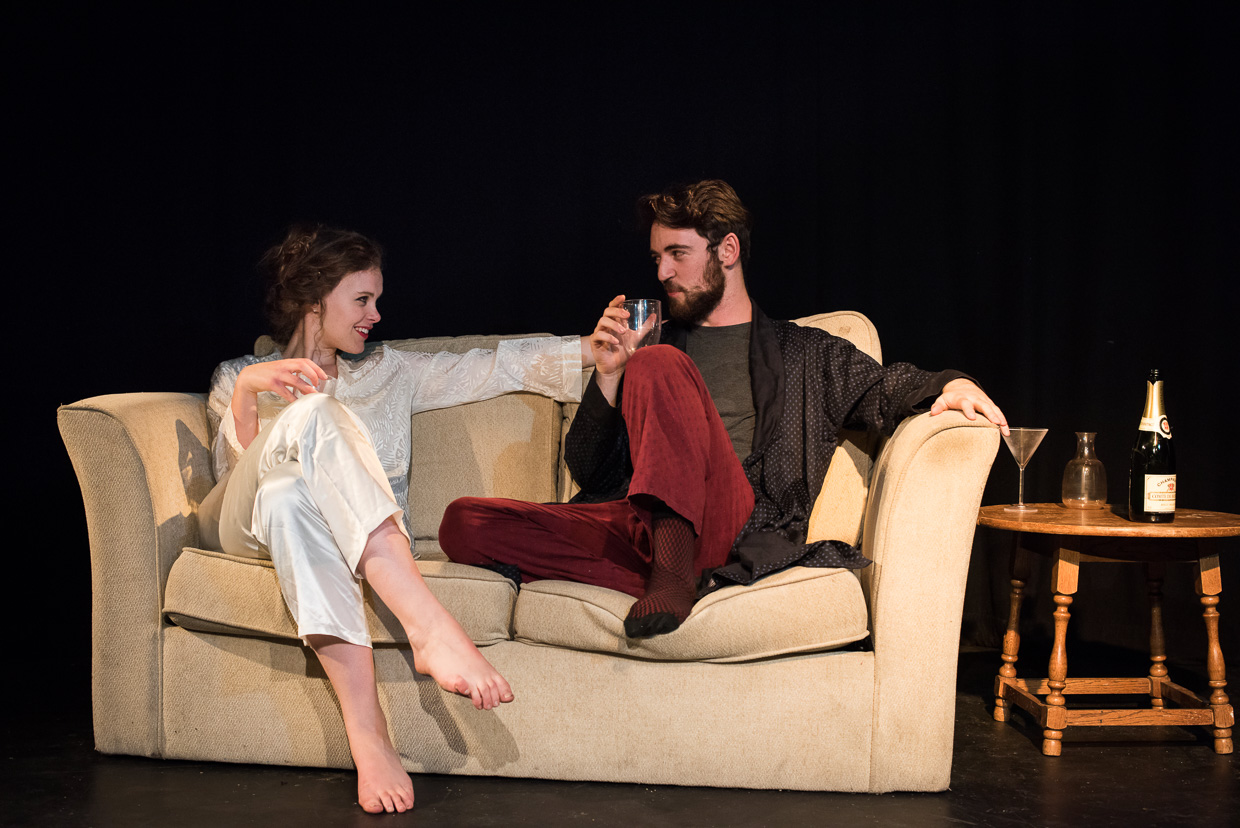 Bethan Davidson and Will Bishop, sitting in a sofa together