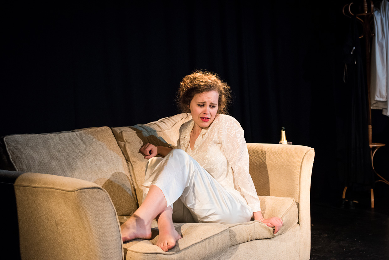 Bethan Davidson in a beige sofa