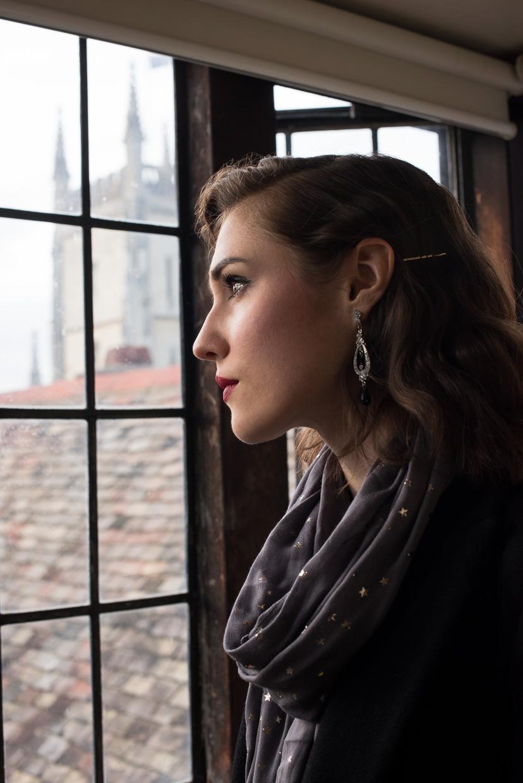 Hannah Grace Taylor looking out a window in Pembroke Colllege