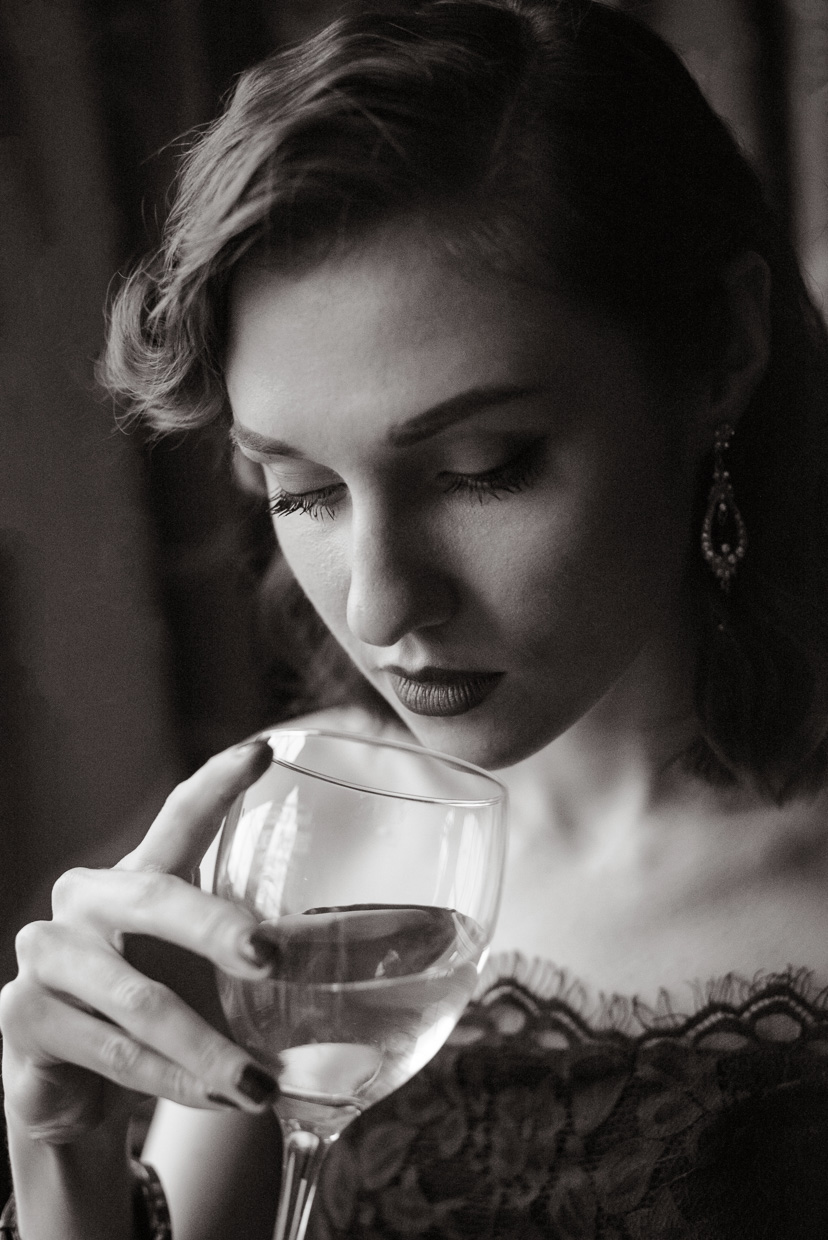 Portrait of Hannah Grace Taylor drinking white wine
