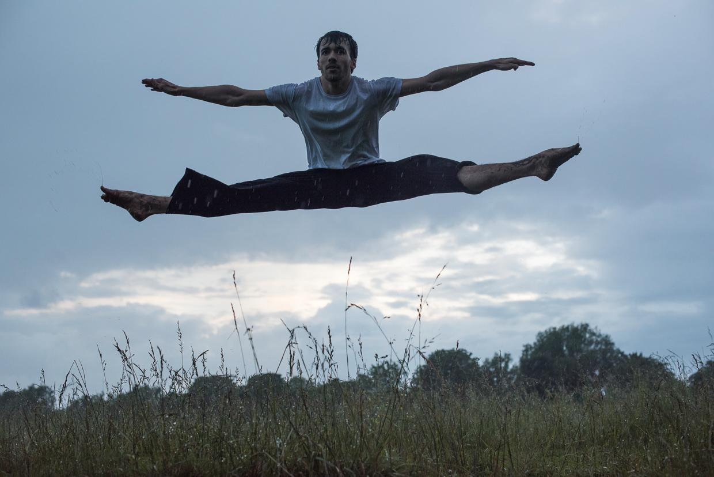 Rafael San Martin jumping, arms and legs parallel