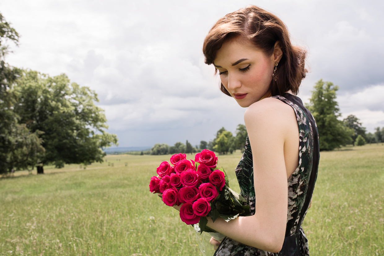 Hannah Grace Taylor with red roses in a field
