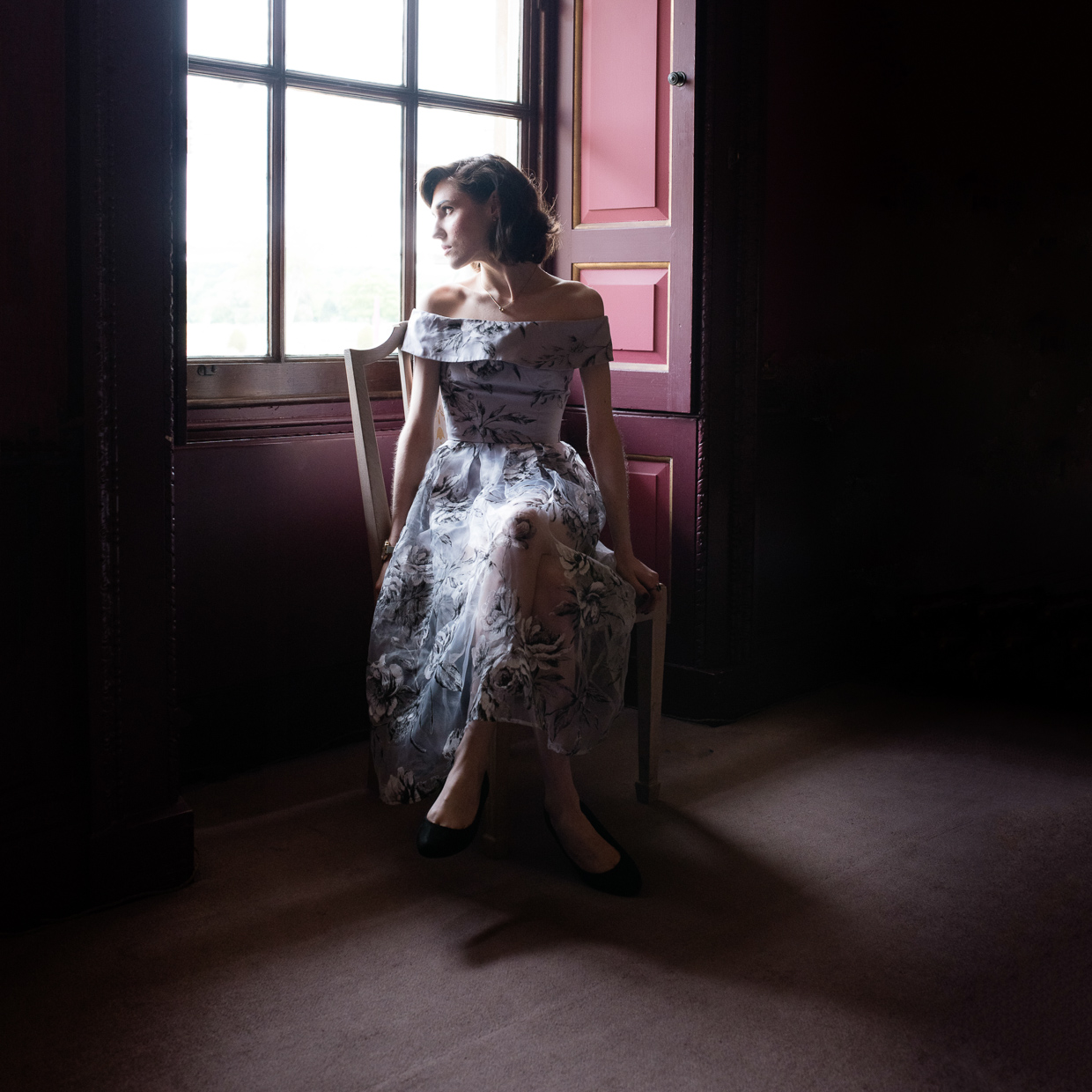 Hannah Grace Taylor in an amazing dress by a window at Wimpole Estate