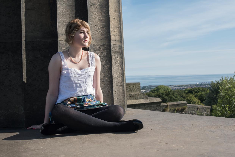 Hettie Blohm sitting on the National Monument of Scotland in Edinburgh.