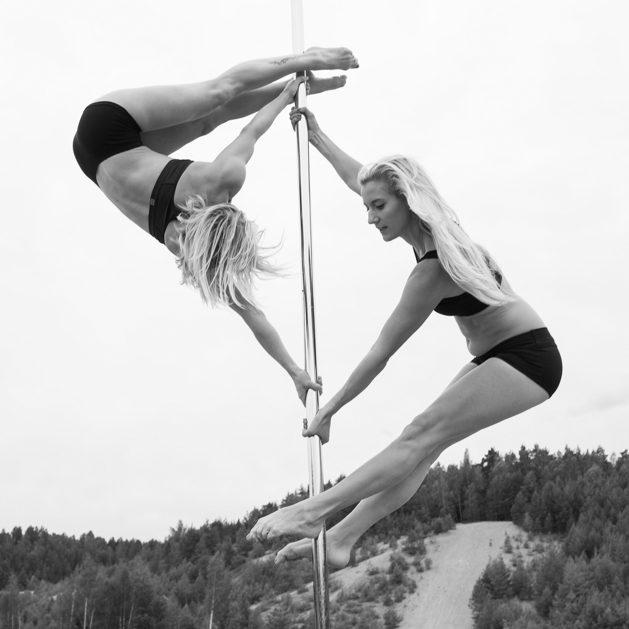 Therese Larsson and Helle Carlstedt pole dancing together.