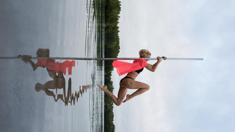 Lenita Larsson on a pole dancing pole.