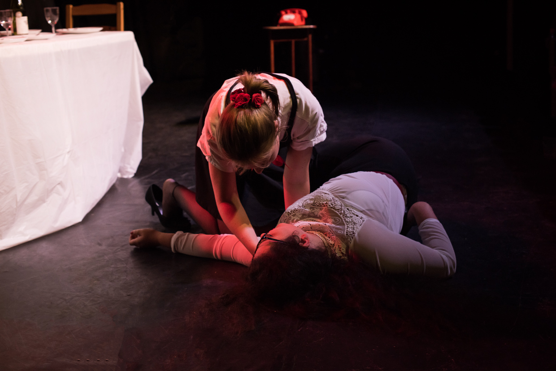 Posey has been shot, Rebecca kneeling by her side.