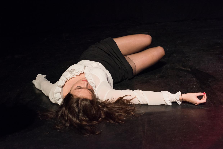Rebecca lying on the floor.