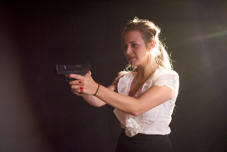 Olivia aiming the gun.