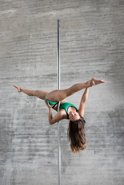 Alexandra Mellin in a Jade Split on a pole dancing pole