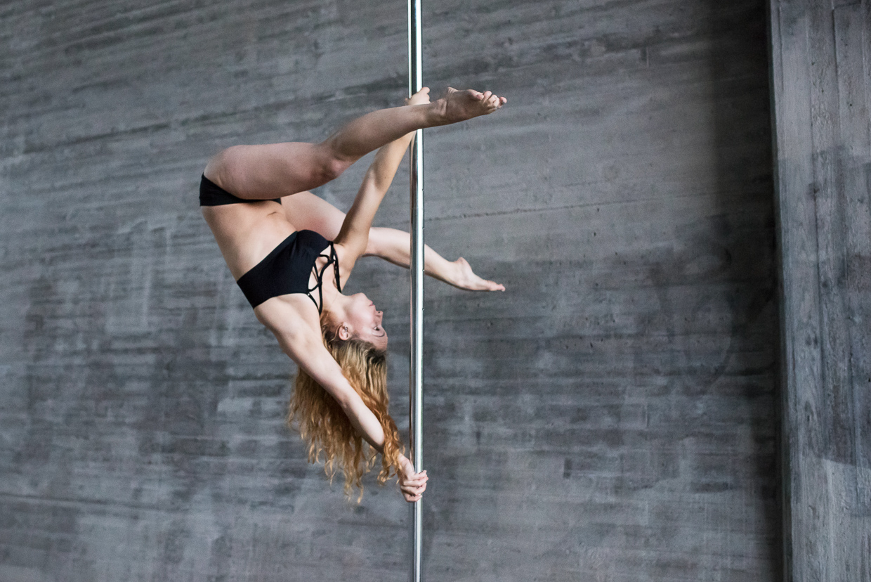 Filippa in a handspring pose on the pole