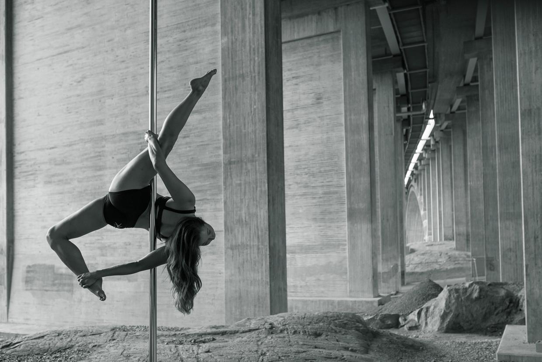 Alexandra Mellin in Allegra pole dancing pose