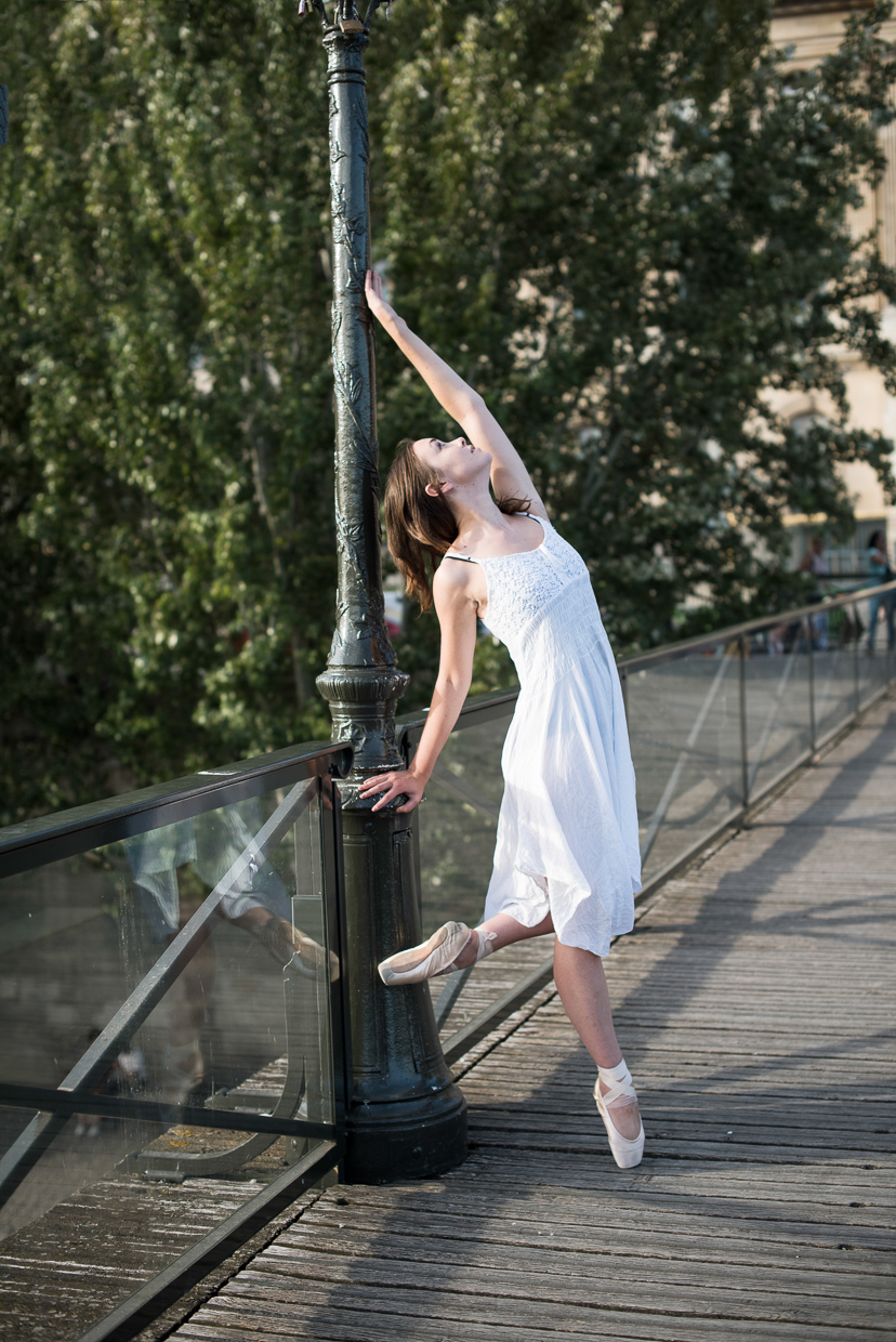 Annie Magee posing on a bridge in Paris