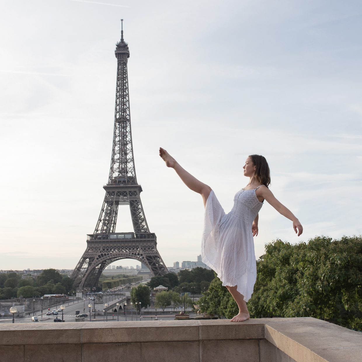 Annie Magee balancing on the railing at Palais de Chaillot