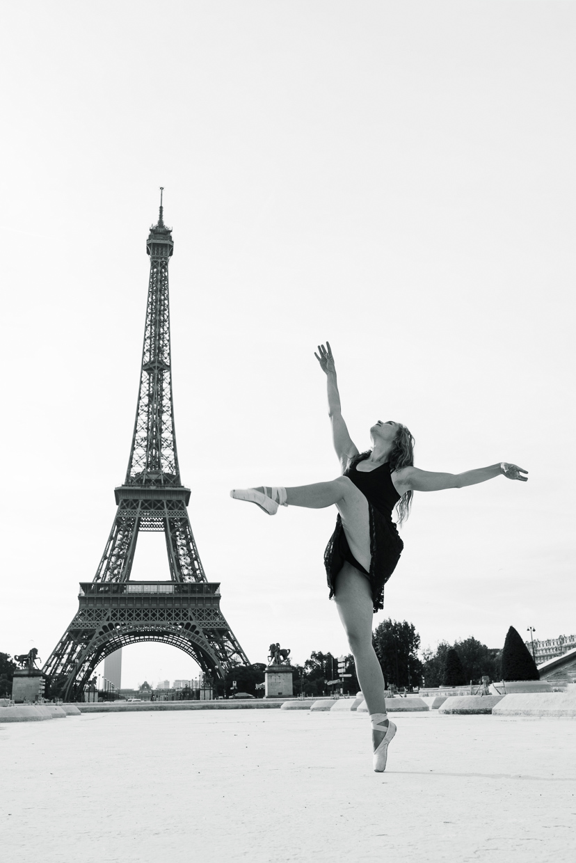Lucy McMahon dancing in front of Eiffel Tower