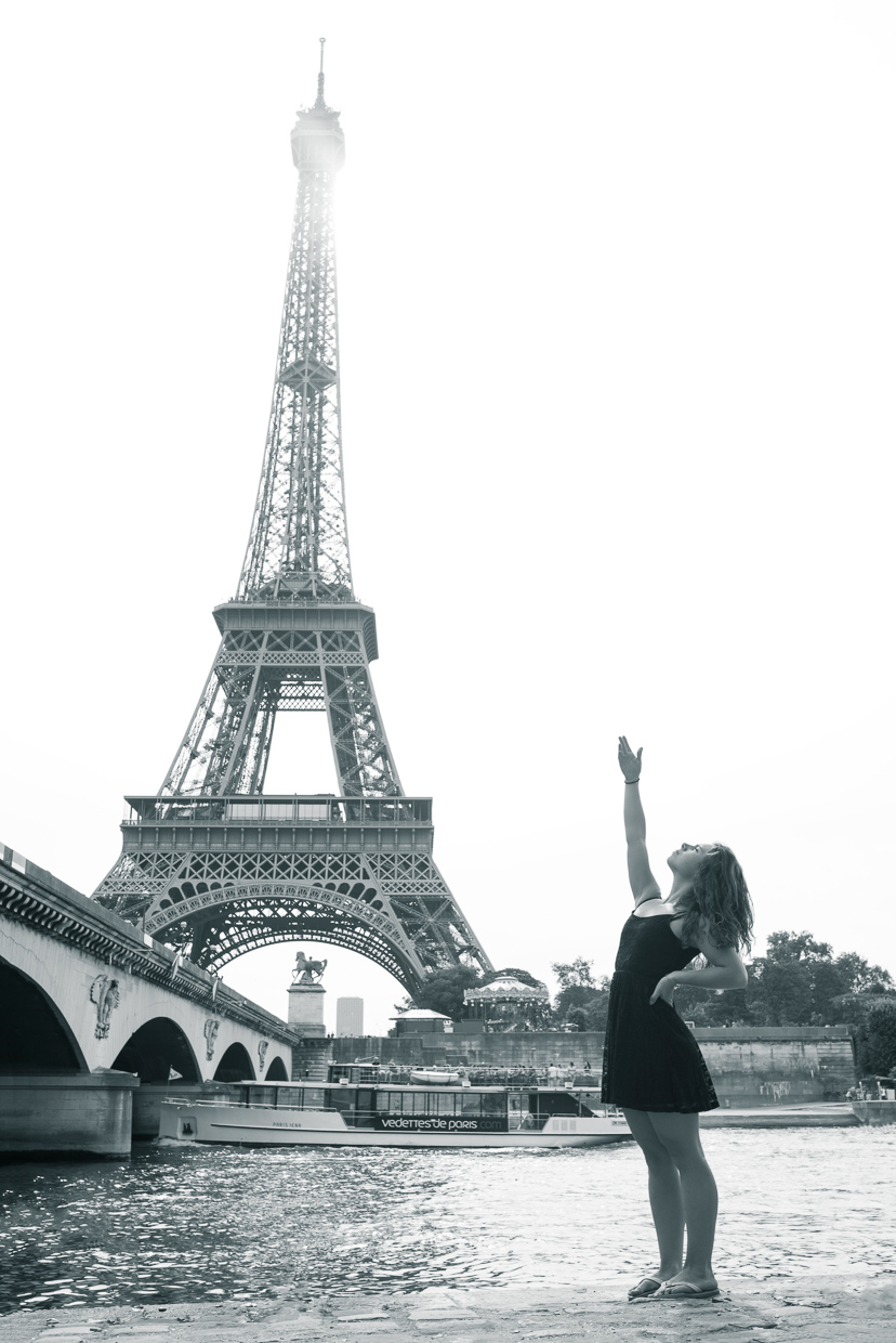 Genevieve McMahon by the river banks of Seine in front of Eiffel Tower