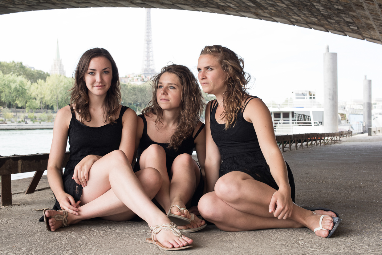 Annie Magee, Genevieve McMahon and Lucy McMahon under a bridge, by the riverbank of Seine