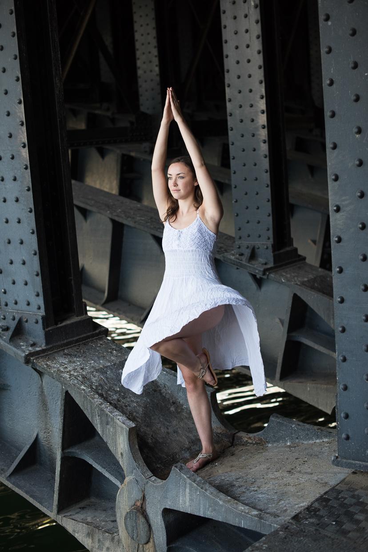 Annie Magee doing yoga under a bridge in Paris